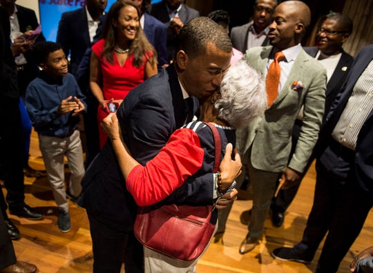 Mayor-elect Steven Reed hugs his mom, Mollie, before giving his acceptance speech at the Warehouse in the Alley in Montgomery, Ala., on Tuesday, Oct. 8, 2019.