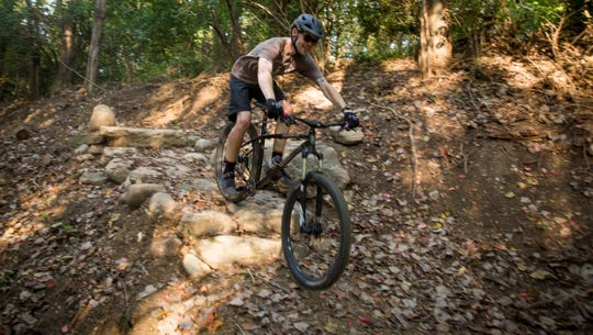 Cameron Hill takes his bike through one of the intermediate mountain bike trails that was just recently constructed at Prairie Creek Reservoir. The trails, which are still under construction start at the southwest corner of the reservoir.
