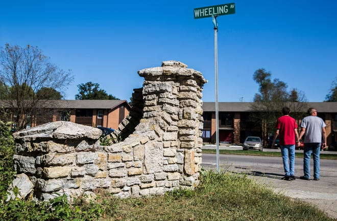 Several stone structures, including two forming the entryway to Cowing Drive on Wheeling Avenue, are slated to be moved for sidewalk construction.
