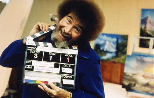 "Bob Ross at the L.L. Ball House in Muncie, having fun while filming his show, ""The Joy of Painting."""