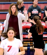 Stewarts Creek's head coach Mary Dayton gives a high-five to Stewarts Creek's McKenna Young (13) as she come to the bench during a game against Blackman in the District 7-AAA volleyball tournament on Tuesday Oct. 8, 2019, at Oakland.