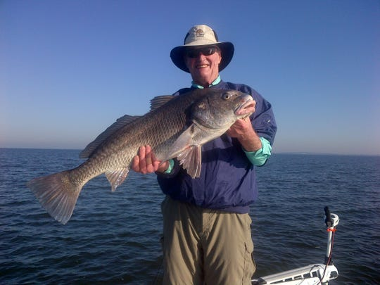 This 2012 picture shows Chip Healy with a red fish he landed in Louisiana
