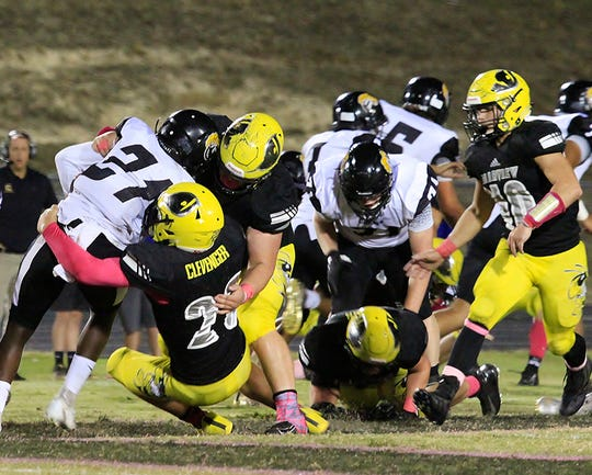 The Fairview Jackets' defense work together to prevent a Camden Lions first down on Oct. 4, 2019.
