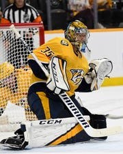 Predators goaltender Pekka Rinne (35) deflects a San Jose Sharks shot during the second period on Tuesday.
