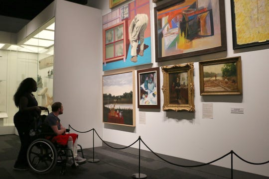 Visitors to the Tennessee State Museum gallery, In Search of the New: Art after 1900.