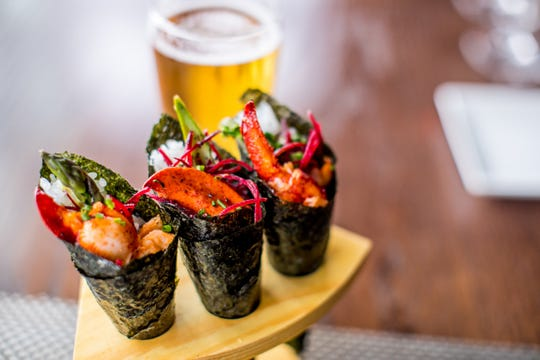 Lobster Temaki: nori cones of butter-poached lobster, asparagus, beets, wasabi aioli.