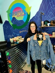 Orbital Outdoors owner Kelsey Silverstein shows off a vintage Banana Republic jacket that she has priced at $90.
