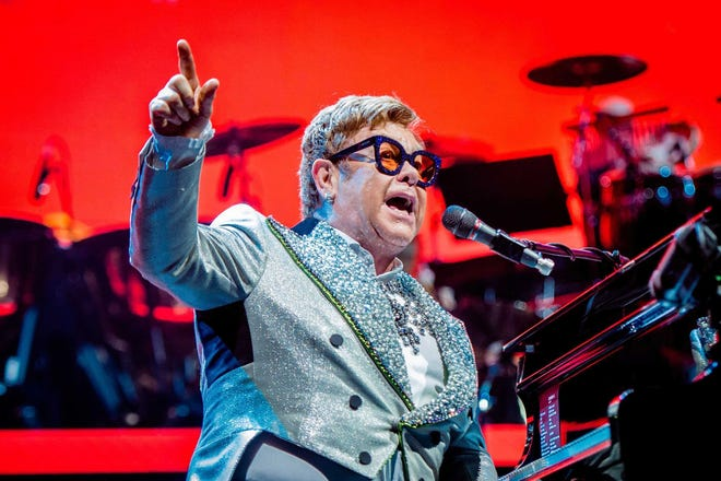 Elton John performs on stage at the Ziggo Dome in Amsterdam, the Netherlands on June 8, 2019, as part of his 'Farewell Yellow Brick Road' Tour. He announced Oct. 9, 2019, that he will perform in Jacksonville, Florida, in 2020.