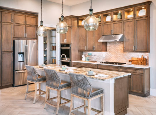 Azure at Hacienda Lakes recently introduced the one-story, 2,504 square-foot Piper home design featuring three bedrooms, three and one-half baths, a gourmet kitchen, a study, and a three-car tandem garage.