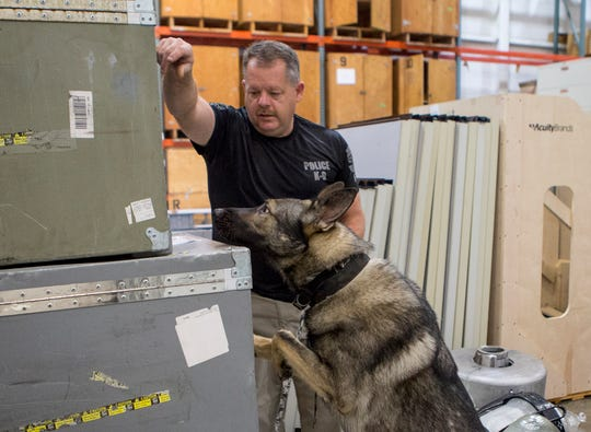 Newark K9 officer Jon Purtee works with his K9 dog Xudo during drug sniffing exercises. Every other week K9 officers spend the day with their K9 dogs doing training exercises to keep them sharp.