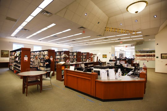 Photo of the Information Desk at the Ridgewood Public Library on 10/09/19. The Library just got a $1 million matching grant from the Bolger Foundation for a comprehensive renovation project.