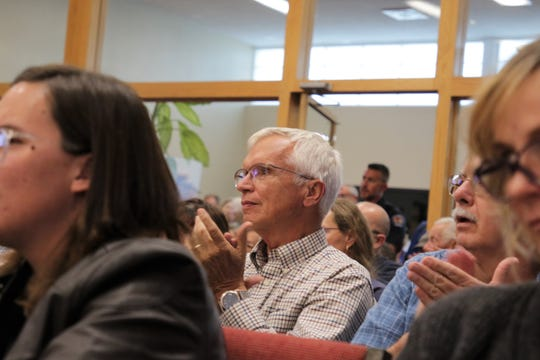 Audience members applaud, Tuesday, Oct. 8, 2019, during the Farmington City Council meeting.