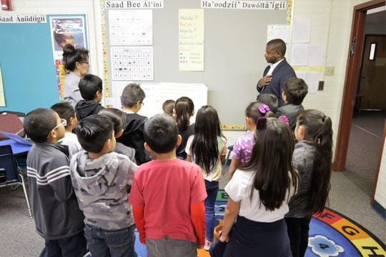 Ryan Stewart, the New Mexico Secretary Designate of Public Education,  back right, visits the classroom of Betty Wilson at Apache Elementary School in Farmington on Oct. 9. He toured Apache and Ladera Del Norte elementary schools during his trip.