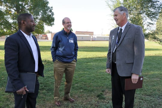 Ryan Stewart, the New Mexico Secretary Designate of Public Education, left, speaks with Farmington Municipal School District Board of Education President Kyle Rhodes, center, and Farmington schools Superintendent Gene Schmidt during a tour  of Apache Elementary School on Oct. 9.