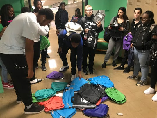 Cambridge students receive a free backpack filled with school supplies.