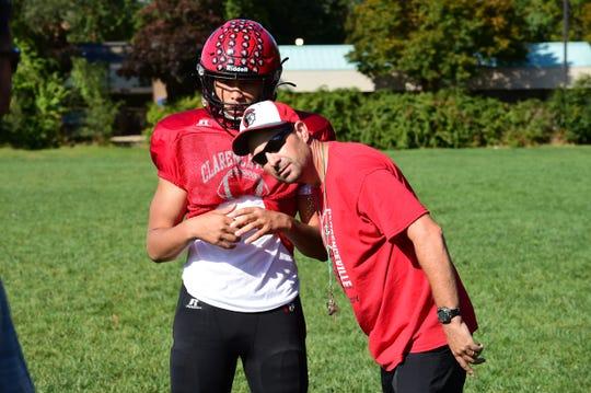 Clarenceville defensive coordinator Jason Sommerville looks on as the Trojans practice.