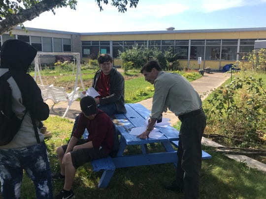 Social studies teacher Gary Gaden uses Cambridge's courtyard as a natural teaching environment.