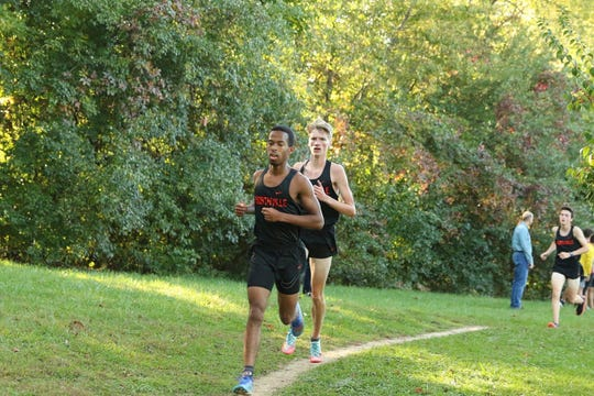 Northville cross country runners Josh Hardy (front) and Josh Morrisey race against Novi.