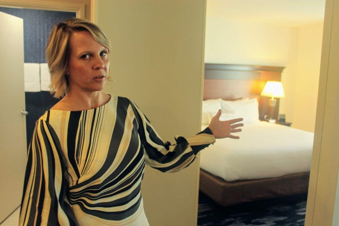 Jen Zeiger, the area director of operations for Hotel Investment Services, shows a renovated guest room at the Fairfield Inn and Suites in Livonia.