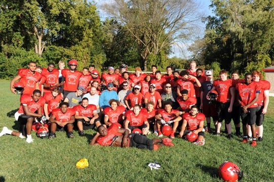The Clarenceville football team poses for a picture after a practice.