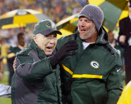 In this Nov. 26, 2015, photo, Brett Favre, right, smiles at Bart Starr during a ceremony at halftime of the game between the Green Bay Packers and Chicago Bears in Green Bay.
