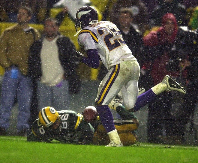 The ball dropped by Vikings cornerback Chris Dishman hits the arm of Packers receiver Antonio Freeman as he lies on the ground. Freeman kept the ball from hitting the ground and ran for a touchdown to give the Packers a 26-20 on Nov. 6, 2000.