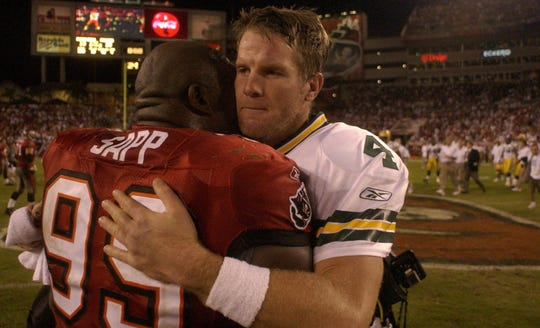Packers quarterback Brett Favre embraces the Tampa Bay Buccaneers' Warren Sapp following Green Bay's 20-13 win on Nov. 16, 2003, at Raymond James Stadium in Tampa, Fla.