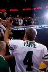 Brett Favre acknowledges fans after becoming the all-time leader in career passing yards while playing the St. Louis Rams on Dec. 16, 2007, at the Edward Jones Dome in St. Louis.