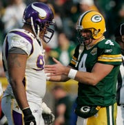 Green Bay Packers quarterback Brett Favre talks with Minnesota Vikings defensive tackle Kevin Williams during a TV timeout in the fourth quarter of their game on Nov. 10, 2007, at Lambeau Field.