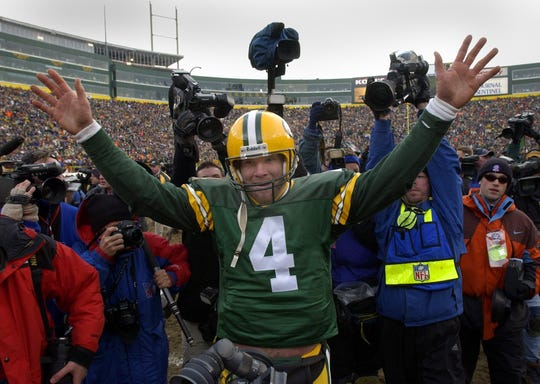 Green Bay Packers quarterback Brett Favre is exalted after leading his team to victory following their game against the San Francisco 49ers on Jan. 13, 2002, at Lambeau Field in Green Bay.