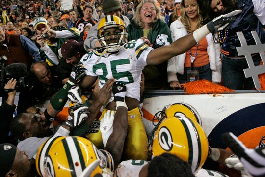 Packers wide receiver Greg Jennings celebrates his game-winning 82-yard touchdown reception in overtime during their game against the Denver Broncos on Oct. 29, 2007, at Invesco Field at Mile High in Denver.