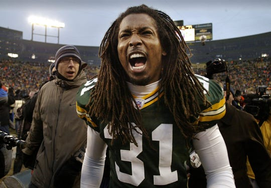 Green Bay Packers Al Harris celebrates after he returned an interception for the game-winning touchdown in overtime against the Seattle Seahawks on Jan. 4, 2004, at Lambeau Field in Green Bay.