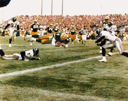 Green Bay Packers quarterback Brett Favre dives into the end zone to score the game-winning touchdown against the Atlanta Falcons December 18, 1994 at Milwaukee County Stadium. It was the last football game played there.