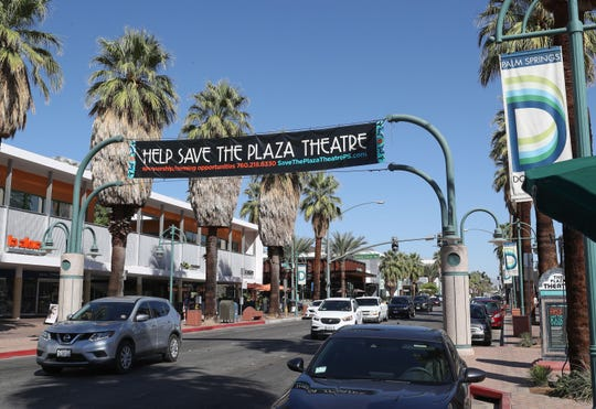 "A banner asks onlookers to ""help save the Plaza Theatre"" in downtown Palm Springs on Oct. 8, 2019."