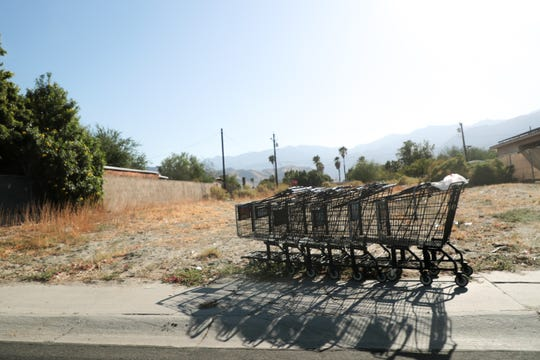 A row of shopping carts sit in an empty lot in the Cathedral City, Calif. Dream Homes neighborhood on Tuesday, October 8, 2019.