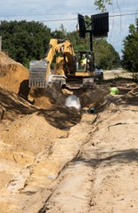 Construction crews install underground utilities in the Bradley Estates subdivision off Chumuckla Highway in Milton on Wednesday.