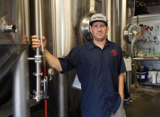 Neal Huttenhow is the head brewer at Saddle Mountain Brewing Company.
