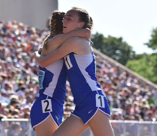 Grace and Lauren Ping hug after winning a race in Minnesota in 2017.
