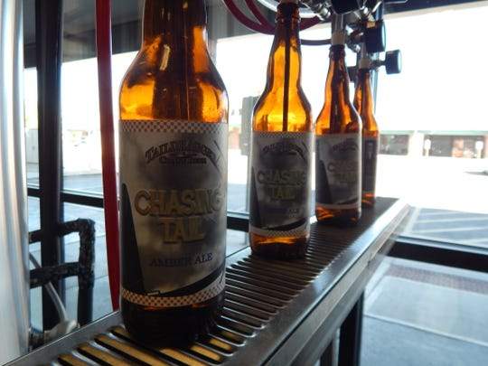 Bottles ready to be filled inside the Saddle Mountain brewery located in Goodyear.
