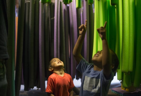 Peter Amarasinghe (right, 4) and his brother, Josiah Amarasinghe (3) play in the Noodle Forest, September 26, 2019, at the Children's Museum of Phoenix, 215 N 7th St., Phoenix.
