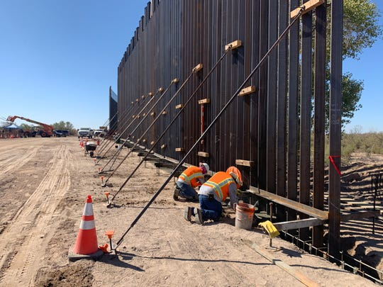 Crews install five miles of 30-foot bollards along the Colorado River near Yuma on Oct. 1, 2019. Border Patrol hopes it will discourage migrants from crossing the border illegally through this area.