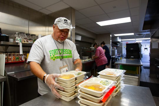 Abel Salas stacks meals that are ready to be packed and delivered from the Foundation for Senior Living, Oct. 3, 2019.