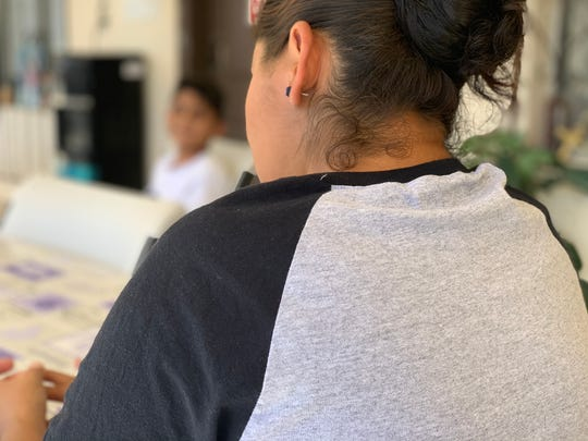 Honduran asylum seeker Welsy Duvo, 30, and her 9-year-old son Alex were sent back to Mexicali to wait for their proceedings under the Migrant Protection Protocols. They're staying at a Catholic shelter until their next court hearing in San Diego.