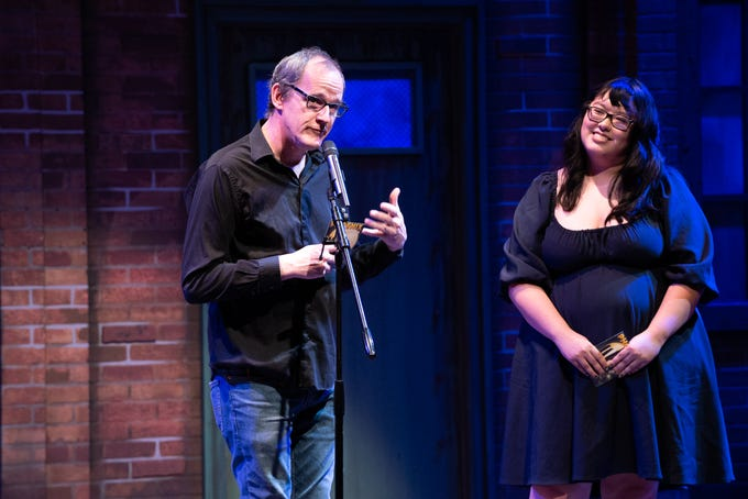Co-Hosts Ed Masley and Lorraine Longhi warm up the crowd during Arizona Storytellers Project presents Music, Movies and Me at the Phoenix Theatre Company on Monday, Oct. 7, 2019.