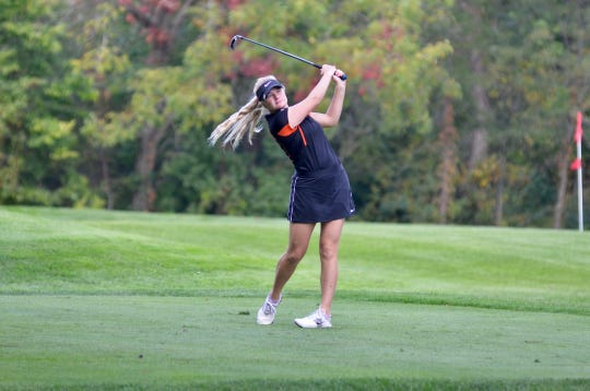 Almont girls golfer Brandi Kautz swings during the Division 4 regional Wednesday, Oct. 9, 2019, at Fox Hills Golf & Banquet Center in Plymouth.
