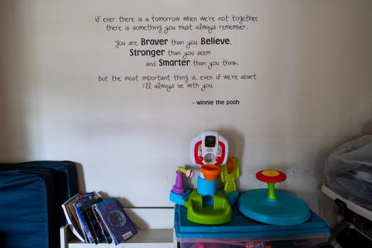 A quote from Winnie the Pooh is written on the wall in the family room at Pathway Homeless Shelter in Port Huron. The shelter transitioned to being exclusively for women and children after Detroit Rescue Mission took control of it in April 2018.