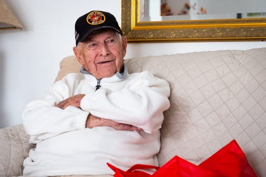 Jim Bradley, 94, a Marine veteran, smiles while telling the story of how he met Rene Gagnon during World War II to relatives of Gagnon Wednesday, Oct. 9, 2019. Gagnon is one of the soldiers who raised the flag at Iwo Jima.