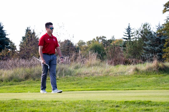 Port Huron High School girls' golf coach Andrew Miron watches during a practice at Solitude Links Golf Course Tuesday, Oct. 8, 2019.