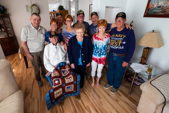 Jim Bradley, 94, front left, a Marine veteran, poses for a photo with relatives of Rene Gagnon and their spouses Wednesday, Oct. 9, 2019. Gagnon was one of the soldiers who raised the flag at Iwo Jima.