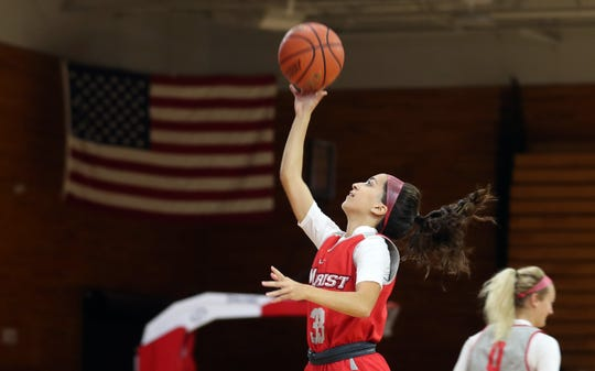 Former Arlington High School basketball standout Camille Loussedes is now hitting baskets for the Marist Red Foxes, as she practices with her new team Oct. 9, 2019.